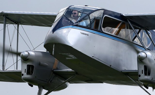 ARDMORE, NEW ZEALAND - SEPTEMBER 29:A pilot flies a vintage de Havilland plane during an airshow commemorating the completion of the rebuild of Havilland Mosquito KA 114, on September 29, 2012 in Ardmore, New Zealand. The plane was restored by Warbird Restorations at Ardmore Aerodrome and is the only flying Mosquito in the world. (Photo by Simon Watts)