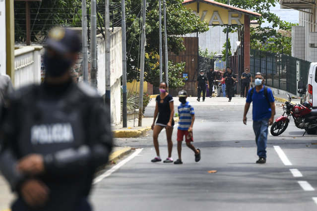 Security forces, back, leave a facility in the Macuto area in La Guiara, Venezuela, Sunday, May 3, 2020. Interior Nestor Reverol said on state television that Venezuelan forces overcame an armed maritime incursion by boats through the port city of La Guaira from neighboring Colombia before dawn Sunday, in which several attackers were killed and others detained. (Photo by Matias Delacroix/AP Photo)