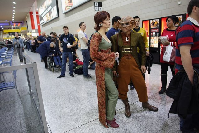 "A woman dressed as the Star Trek character 'Leeta' (C) and man dressed as 'Rom' (2R) arrive to attend the ""Destination Star Trek London"" convention at the ExCeL centre on October 19, 2012 in London, England. The three-day convention, which opened to the general public today, will be attended by all five actors who played captains throughout the 46-year-old series.  (Photo by Oli Scarff)"