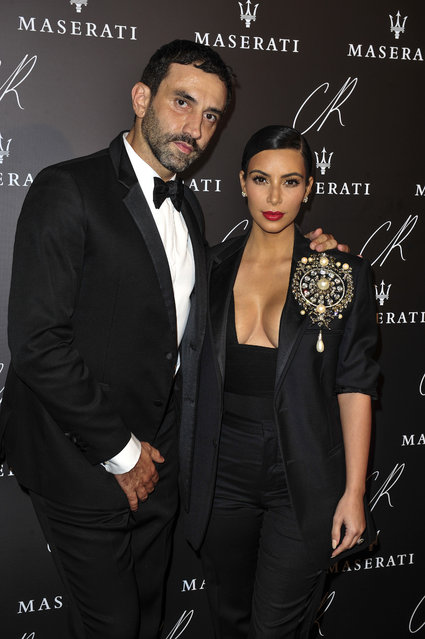 Kim Kardashian, right, and Riccardo Tisci  pose at Carine Roitfeld & Stephen Gan celebration of the launch of CR Fashion Book N.5 in Paris, Tuesday, September 30, 2014. (Photo by Zacharie Scheurer/AP Photo)