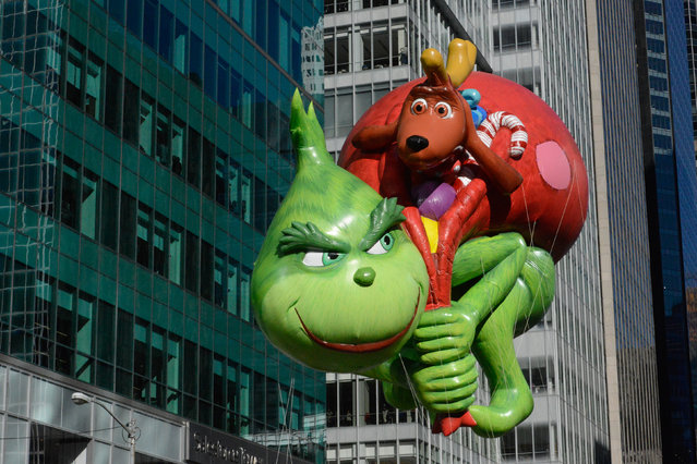 The Grinch balloon floats on 6th Ave. during the annual Macy's Thanksgiving Day parade on November 23, 2017 in New York City. The Macy's Thanksgiving Day parade is the largest parade in the world and has been held since 1924. (Photo by Stephanie Keith/Getty Images)