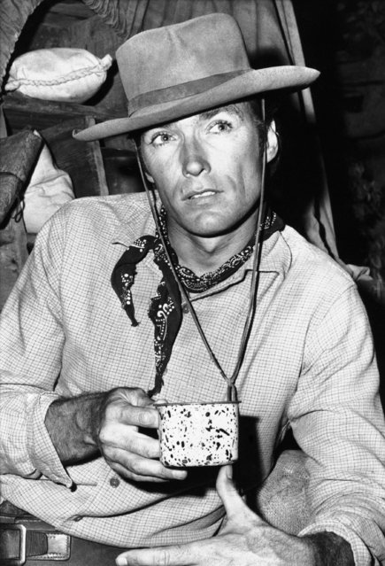 """Clint Eastwood, who's to take over in the fall as the No. 1 star of television's """"Rawhide"""" after a long time as co-star, stops for coffee during filming in Hollywood, July, 31, 1965. Eastwood, first spotted as a potential cowboy-type actor when he was a GI, recently became a top star in Italy thanks to his role in a European film widely exhibited in Italian movie houses. (Photo by AP Photo/DFS)"""