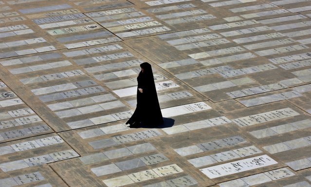 An Iranian woman walks past grave slabs as she arrives to visit the Abdol Azim holy shrine in the city of Shahre Ray, south of Tehran, Iran, 25 May 2020. Media reported that Iran reopened its holy shrines in the country amid the ongoing coronavirus COVID-19 pandemic. Countries around the world are gradually easing COVID-19 lockdown restrictions in an effort to restart the economy and help people in their daily routines. (Photo by Abedin Taherkenareh/EPA/EFE)