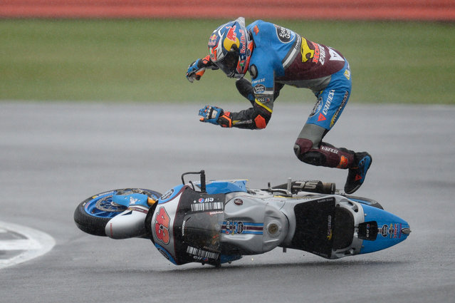 Marc VDS Racing Team's Australian rider Jack Miller comes off his Honda during MotoGP qualifying at the motorcycling British Grand Prix at Silverstone circuit in Northamptonshire, southern England, on September 3, 2016. (Photo by Oli Scarff/AFP Photo)