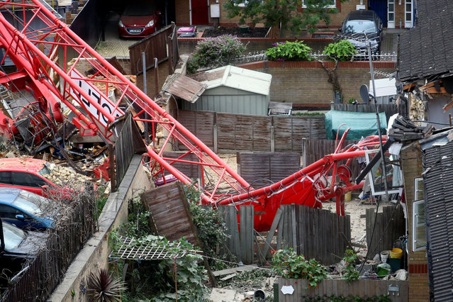 A collapsed crane is seen near a construction site in Bow, east London, Britain, July 8, 2020. (Photo by Hannah McKay/Reuters)