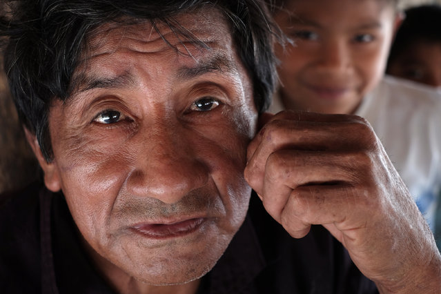 "Aldenir Guajajara, 73, vice chief of the village of Bacuri Dois in Araribóia Indigenous Reserve, Maranhão, Brazil on August 8, 2015. Some members of some villages have sold trees. He said ""Nobody messes with wood here. It's a while since anyone messed with wood. It's much better to work with in the fields, with manioc, to sustain the family."" (Photo by Bonnie Jo Mount/The Washington Post)"