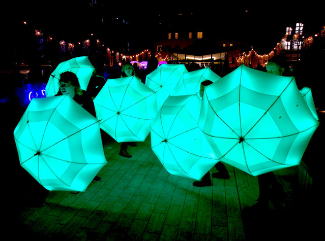 """Umbrella Project"" by Cirque Bijou during Lumiere London festival of light 2018 on January 18, 2018 in London, England. (Photo by Jack Dredd/Rex Features/Shutterstock)"