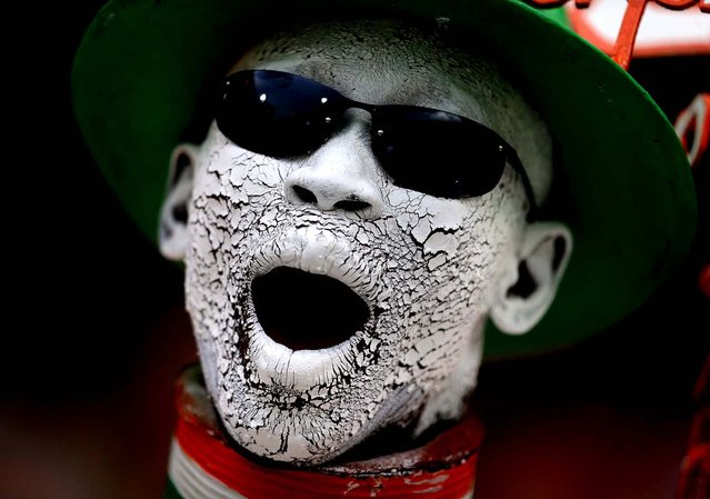An Ivory Coast supporter shouts from the stands while waiting for the start of their African Cup of Nations quarterfinals match with Nigeria at the Royal Bafokeng stadium in Rustenburg, South Africa, on February 3, 2013. (Photo by Armando Franca/Associated Press)