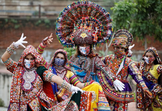 Participants in traditional costumes wearing face masks pose for a picture during rehearsals for Garba, a folk dance, ahead of Navratri, a festival during which devotees worship the Hindu goddess Durga and youths dance in traditional costumes, amidst the coronavirus disease (COVID-19) outbreak, in Ahmedabad, India, September 12, 2020. (Photo by Amit Dave/Reuters)