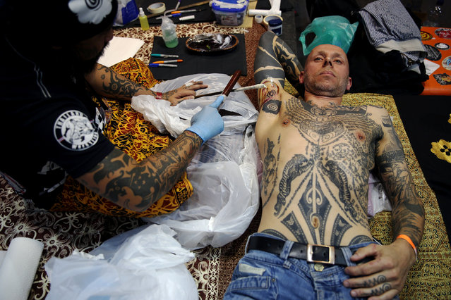 A man is tattooed at the International London Tattoo Convention in London, Britain September 23, 2016. (Photo by Neil Hall/Reuters)