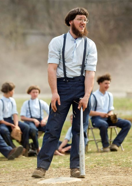 Freeman Burkholder waits for his at bat during a game of baseball at the farewell picnic in Bergholz, Ohio on Tuesday, April 9, 2013. The picnic was for Burkholder and other Amish people leaving for prison this week for their part in the hair and beard cutting scandal against other Amish members. (Photo by Scott R. Galvin/AP Photo)