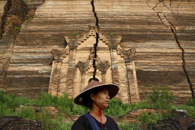 Handicraft vendor Zar Zar, 28, poses as she waits for tourists in front of the ruins of the temple Pahtodawgyi in Mingu, Myanmar, October 7, 2015. (Photo by Jorge Silva/Reuters)