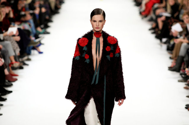 A model presents a creation by Ukrainian designer  Oksana Berg during Ukrainian Fashion Week in Kiev, Ukraine, October 12, 2016. (Photo by Gleb Garanich/Reuters)