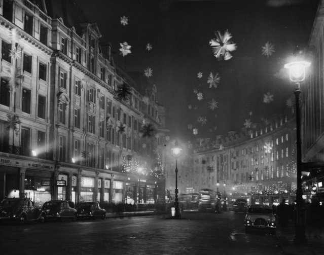 Christmas decorations in Regent Street, London, consisting mainly of snow crystal stars made of aluminium to give the effect of a snowstorm, 30th November 1955. (Photo by Keystone/Getty Images)