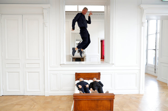 "Italian artist Maurizio Cattelan poses with his creation ""Is There Life Before Death"" (2010), prior to the opening of the exhibition ""Not Afraid of Love"" at the Hotel de la Monnaie in Paris, France, October 17, 2016. (Photo by Philippe Wojazer/Reuters)"
