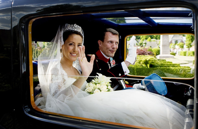 Prince Joachim of Denmark and his bride Princess Marie leave following their wedding in Mogeltonder, May 24, 2008. (Photo by Jeppe Michael Jensen/Reuters/Scanpix)