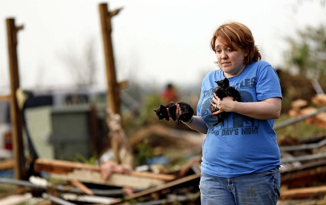 Rachel Hilton holds stray kittens she found in the debris of her parents' home at SW 149th and Stone Meadows Dr. after the tornado struck south Oklahoma City and Moore. (Photo by Nate Billings/The Oklahoman)