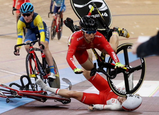 Xiaofei Wang of China (top) and Daria Pikulik of Poland (bottom) crash during the Women's Madison at the UCI Track Cycling World​ Championships at the Velodrom in Berlin, Germany, 29 February 2020. (Photo by Focke Strangmann/EPA/EFE)