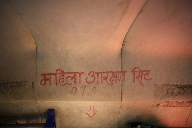 """Seats Reserved for Women"" is written in Nepali inside a women-only bus in Kathmandu January 6, 2015. (Photo by Navesh Chitrakar/Reuters)"