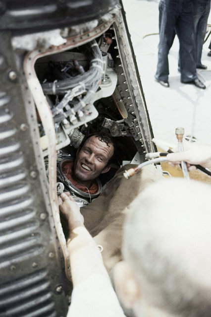 Astronaut Leroy Gordon Cooper broke into a broad grin at the greeting given to him aboard the carrier Kearsarge after his 22-orbit earth flight in May of 1963. Cooper and his spacecraft, Faith 7, were lifted from the Pacific Ocean by a helicopter from the Kearsarge on May 17, 1963. It was the longest U.S. space flight to date. (Photo by AP Photo)