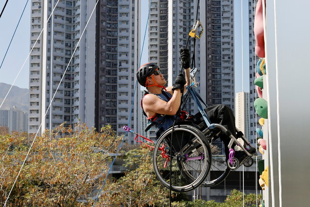 Lai Chi-wai, a paraplegic climber, attends a training session, ahead of his attempt to climb the 320-metre tall Nina Tower using only his upper body strength, in Hong Kong, China on December 29, 2020. (Photo by Tyrone Siu/Reuters)