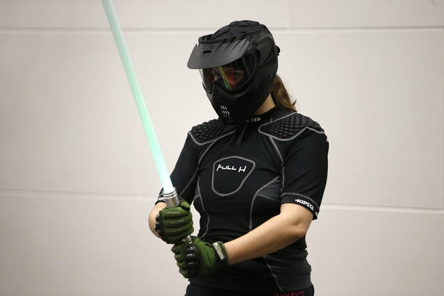 A competitor prepares to participate in a light saber duel tournament organized by the Sport Saber League in Paris, France, October 29, 2015. (Photo by Charles Platiau/Reuters)