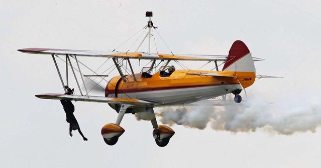 Wing walker Jane Wicker perform at the Dayton Air Show on Saturday. (Photo by Ty Greenlees/Dayton Daily News)