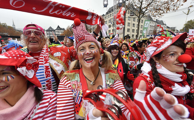 Revellers celebrate the start of the carnival season in the streets of Cologne, Germany, on Friday, November 11, 2016. (Photo by Martin Meissner/AP Photo)