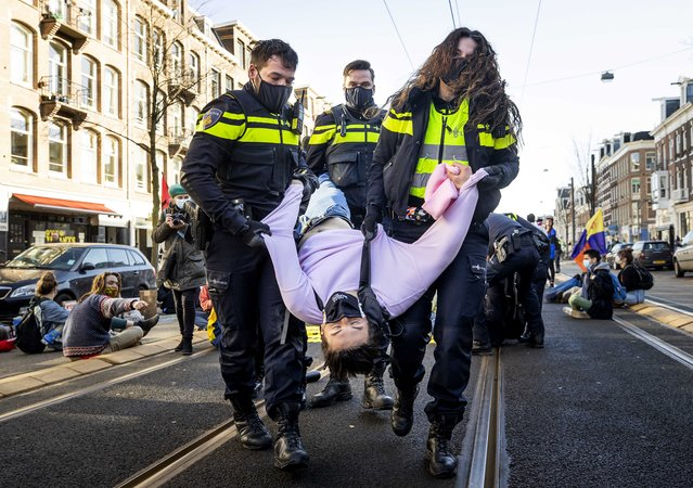 A demonstration of Extinction Rebellion in Amsterdam, the Netherlands, has been dissolved by the local triangle (police, judiciary and mayor), February 26, 2021. About eighty activists, some of whom scantily dressed, blocked the Overtoom in Amsterdam-West. About twenty of them do not want to leave, they are taken away elsewhere. (Photo by Koen van Weel/EPA/EFE)