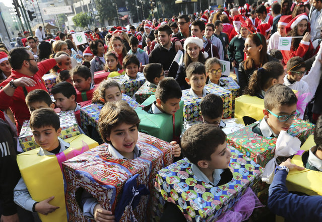 Students dressed up as Christmas gifts take part in a Christmas parade in Beirut, Lebanon, December 22, 2015. (Photo by Aziz Taher/Reuters)