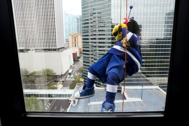 ThunderBug, mascot for the NHL's Tampa Bay Lightning, rappels down the outside of a hotel as part of the annual Over the Edge charity fundraiser for the Big Brothers Big Sisters of Tampa Bay in Tampa, Florida, U.S. March 6, 2021. (Photo by Jonathan Ernst/Reuters)