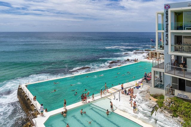 World's Greatest Swimming Pools: Iceberg Pool on Bondi Beach in Sydney, Australia. With a swimming club that first opened in 1929, the public pool and sauna along the Pacific have since become Bondi Beach staples for locals and visitors alike. Log your laps in this saltwater amphitheater – waves often crash over the side! – then cap off your visit with a meal (and spectacular balcony views) at the Icebergs Club Bistro. (From $3.71 per kid and $5.19 per adult for pool and sauna entry). (Photo by Gordon Bell/Alamy Stock Photo)