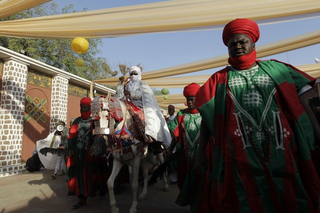 New Emir of Kano Muhamadu Sanusi II gestures to the people as he rides on a horse during his coronation in Kano, Kano State, February 7, 2015. (Photo by Afolabi Sotunde/Reuters)