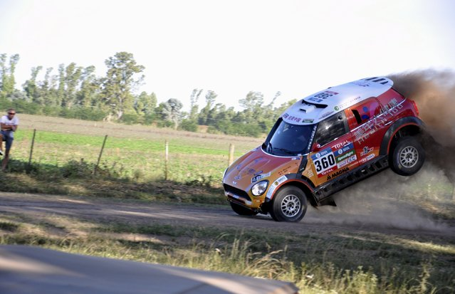 Guo Meiling of China jumps her Mini into the road during the 38th Dakar Rally in Arrecifes, Argentina, January 2, 2016. (Photo by Reuters/Stringer)