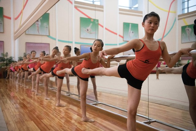 Young ballerinas practice during a lesson at Mansyongdae School Childrens' Palace on August 23, 2018 in Pyongyang, North Korea. (Photo by Carl Court/Getty Images)