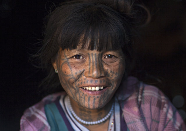 A woman from the Muun tribe who inhabit the hills of the Arakan state. The design, known as the letter B-pattern, is common in the Mindat area. It is composed of dots, lines and occasionally circles, in February, 2015, in Myanmar, Burma. (Photo by Eric Lafforgue/Barcroft Media)