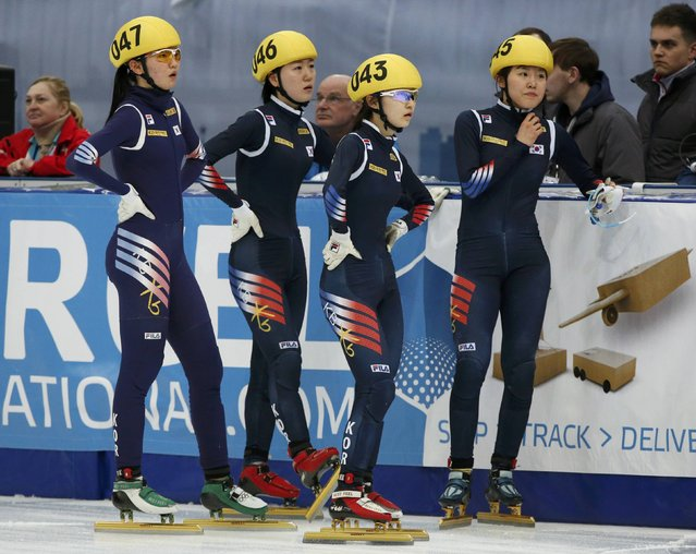 Members of the winning South Korean team Shim Suk Hee, Noh Do Hee, Choi Minjeong and Kim Alang (L-R) look on after finishing during the women's 3000m relay final at the ISU World Short Track Speed Skating Championships in Moscow March 15, 2015. (Photo by Grigory Dukor/Reuters)