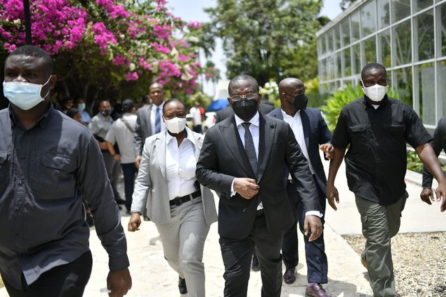 Interim Prime MinisterClaude Joseph leaves a memorial service for late Haitian President Jovenel Moise at the National Pantheon Museum in Port-au-Prince, Haiti, Tuesday, July 20, 2021. Designated Prime Minister Ariel Henry is expected to be sworn in later in the day to replace Joseph, who assumed leadership of Haiti with the backing of police and the military after the July 7 attack at Moïse's private home. (Photo by Matias Delacroix/AP Photo)