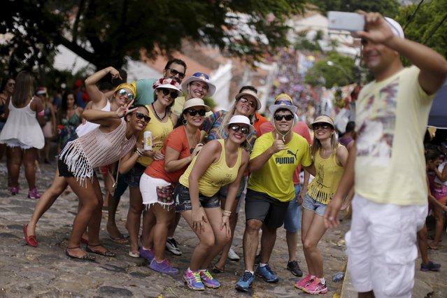 Revellers takes a selfie during a carnival party in a neighborhood in Olinda, Brazil February 9, 2016. (Photo by Ueslei Marcelino/Reuters)