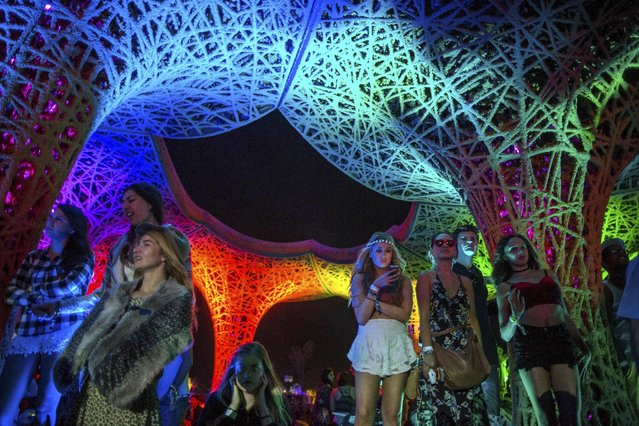 """People listen to AC/DC from under the """"Pulp Pavilion"""" art installation by Ball-Nogues Studio at the Coachella Valley Music and Arts Festival in Indio, California April 10, 2015. (Photo by Lucy Nicholson/Reuters)"""