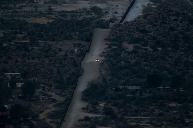 A U.S. Border Patrol vehicle drives along the U.S.-Mexico border fence in Jacumba, California, U.S., November 14, 2016. (Photo by Mike Blake/Reuters)