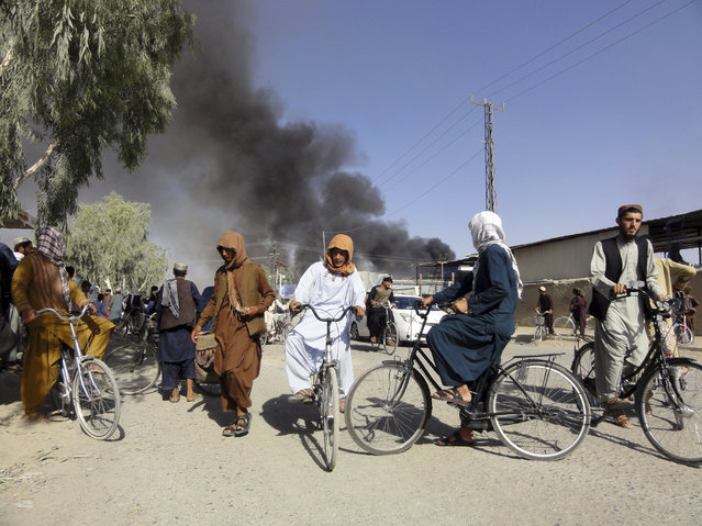Smoke rises after fighting between the Taliban and Afghan security personnel, in Kandahar, southwest of Kabul, Afghanistan, Thursday, August 12, 2021. (Photo by Sidiqullah Khan/AP Photo)
