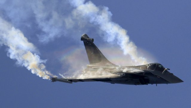 A Dassault Rafale fighter takes part in a flying display during the 49th Paris Air Show at the Le Bourget airport near Paris in this June 25, 2011 file photo. Dassault is expected to report full-year sales this week. (Photo by Gonzalo Fuentes/Reuters)