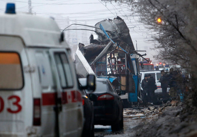 Members of the emergency services work at the site of a bomb blast on a trolleybus in Volgograd December 30, 2013. (Photo by Sergei Karpov/Reuters)