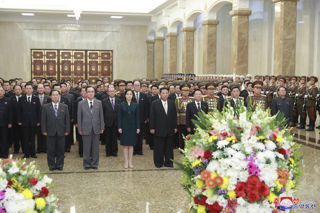In this photo provided by the North Korean government, North Korean leader Kim Jong Un, center right, and his wife Ri Sol Ju, center, left, visit the Kumsusan Palace of the Sun, marking the nation's 73rd anniversary in Pyongyang, North Korea, Thursday, September 9, 2021. (Photo by Korean Central News Agency/Korea News Service via AP Photo)