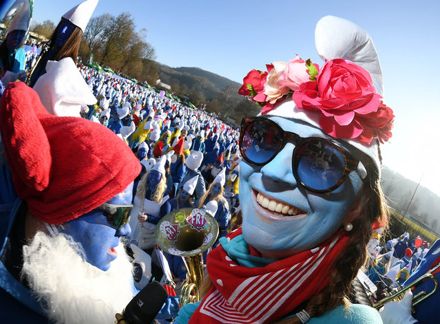 At a world record for the largest smurf meeting in the world, a participant dressed as a smurf looks into the photographer's camera in Baden-Wuerttemberg, Lauchringen, Germany on February 16, 2019. A new world record was set at the meeting with 2762 participants. The previous record of 2510 set in Wales in 2009 was thus surpassed. (Photo by Uli Deck/dpa/Picture Alliance via Getty Images)