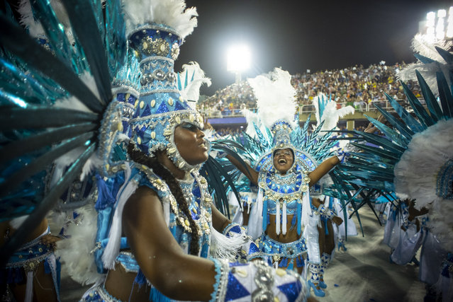 Performers dance during Beija Flor performance at the Rio de Janeiro Carnival at Sambodromo on March 3, 2019 in Rio de Janeiro, Brazil. (Photo by Raphael Dias/Getty Images)