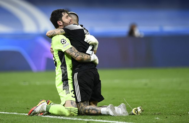 Sheriff's goalkeeper Giorgos Athanasiadis, left, and Sheriff's Dimitris Kolovos celebrate at the end of the Champions League group D soccer match between Real Madrid and Sheriff, Tiraspol at the Bernabeu stadium in Madrid, Spain, Tuesday, September 28, 2021. (Photo by Jose Breton/AP Photo)