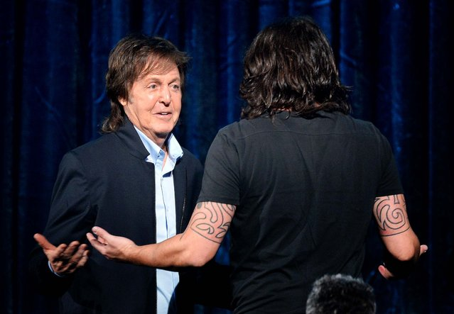 "Paul McCartney and Dave Grohl accept the Best Rock Song award for ""Cut Me Some Slack"". (Photo by Kevork Djansezian/Getty Images)"