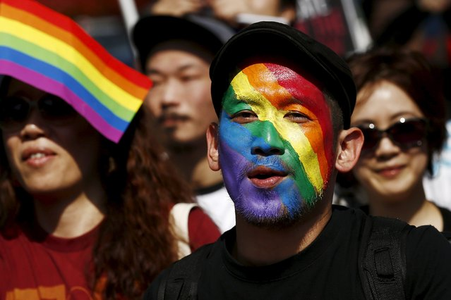 A man whose face is painted in the colours of the rainbow attends the Tokyo Rainbow Pride parade in Tokyo April 26, 2015. (Photo by Thomas Peter/Reuters)